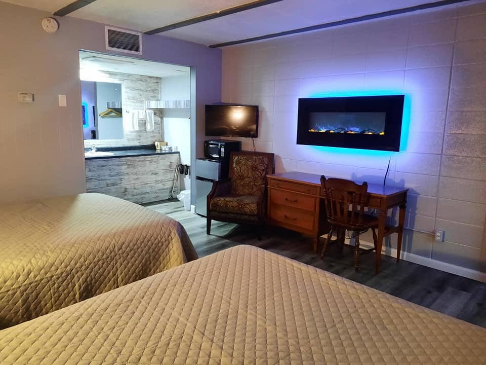 Coachlight Inn updated room with 2 beds, desk, flat screen tv's, mini fridge, and microwave