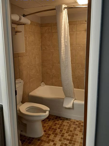 Coachlight Inn new bathtub, shower, and toilet